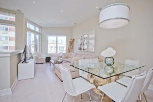 a bright airy dining room with clean white decorations.