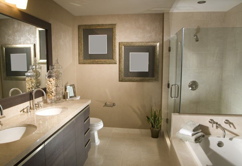 A large luxury bathroom with a glass walled, walk-in shower.