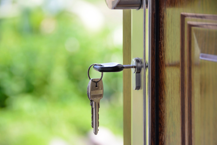 Key in door when renting or buying a home