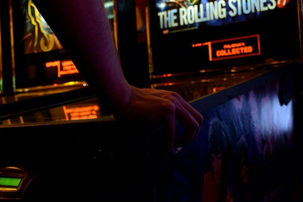 playing pinball at barcade